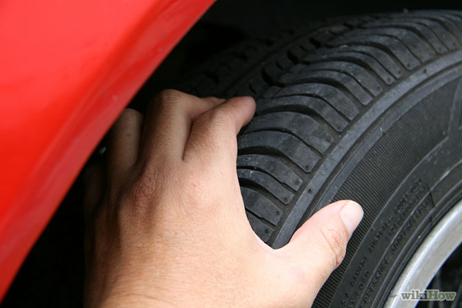 hand on tire Signs your winter tyres need to be replaced